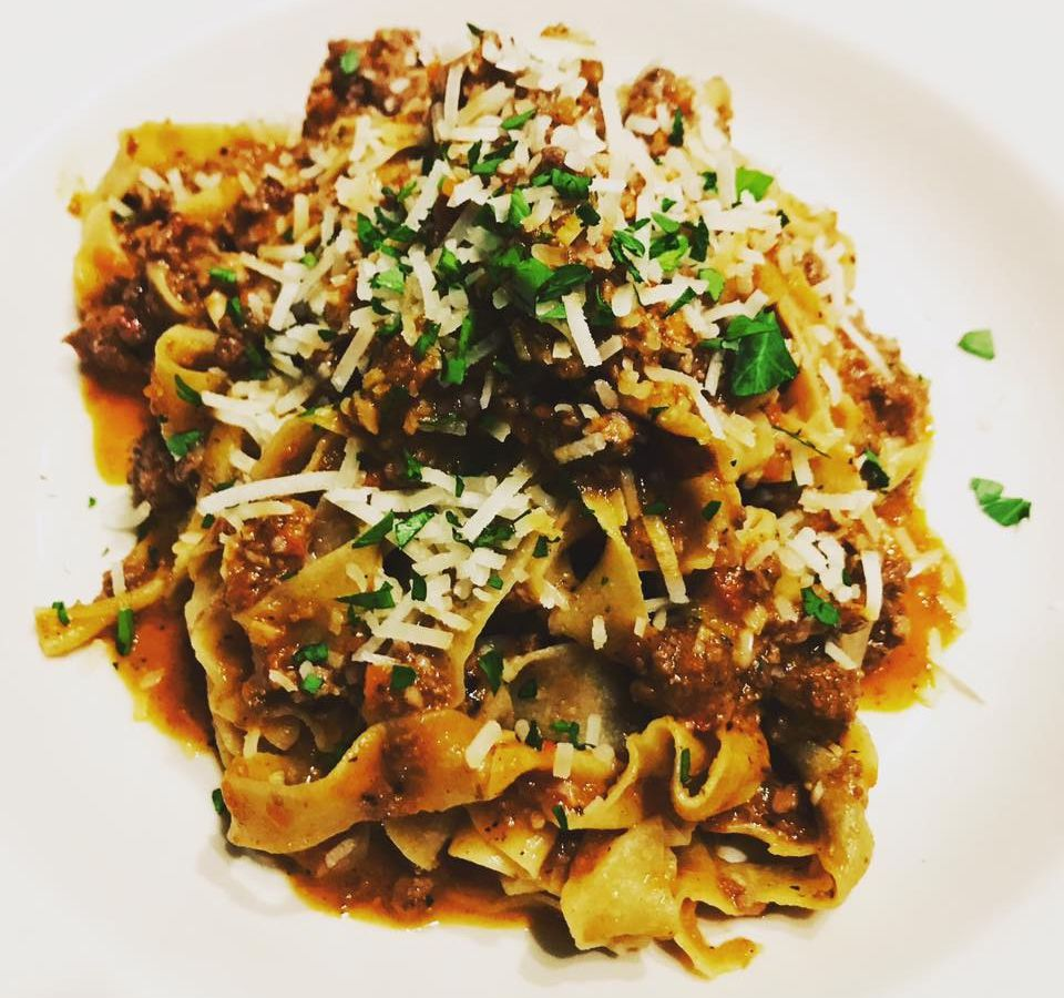 A view of Bizarro Italian Cafe's bolognese with pappardelle and elk, tossed with cheese.