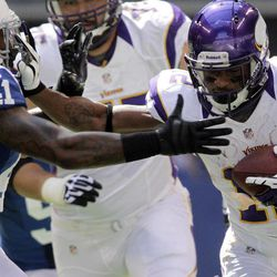 Minnesota Vikings' Percy Harvin, right, runs against Indianapolis Colts' Antoine Bethea during the first half of an NFL football game in Indianapolis, Sunday, Sept. 16, 2012.