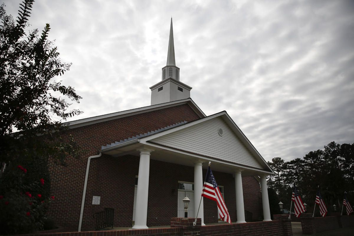 American flags are displayed in front of the First Baptist Church of Gallant, Sunday, Nov. 12, 2017, in Gallant, Ala. Prayer and repentance were among the themes Sunday at the church, which is Alabama Senate candidate Roy Moore's home church. Moore himsel