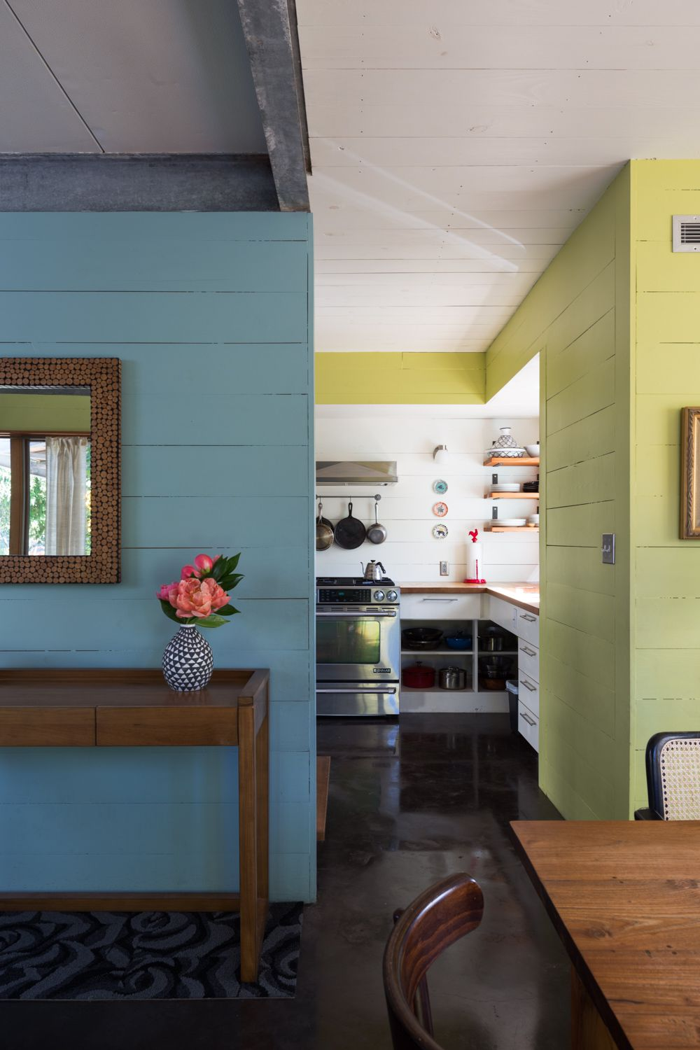 bright green, dusky blue, white walls in transition from dining room to kitchen