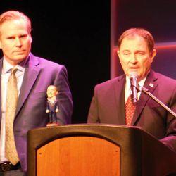 "Salt Lake Comic Con co-founder Dan Farr (left) looks on as Gov. Gary Herbert declared April 17, 2014, ""Comic Con Heroes Day"" in Utah."