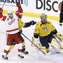 Detroit Red Wings center Pavel Datsyuk (13), of Russia, celebrates a goal by Johan Franzen, not shown, against Nashville Predators goalie Pekka Rinne (35), of Finland, in the second period of Game 2 of an NHL hockey Stanley Cup first-round playoff series, Friday, April 13, 2012, in Nashville, Tenn.