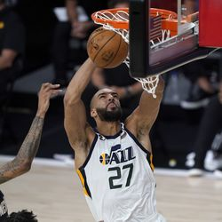 Utah Jazz's Rudy Gobert (27) heads to the basket past New Orleans Pelicans' Brandon Ingram, left, during the second half of an NBA basketball game Thursday, July 30, 2020, in Lake Buena Vista, Fla. (AP Photo/Ashley Landis, Pool)