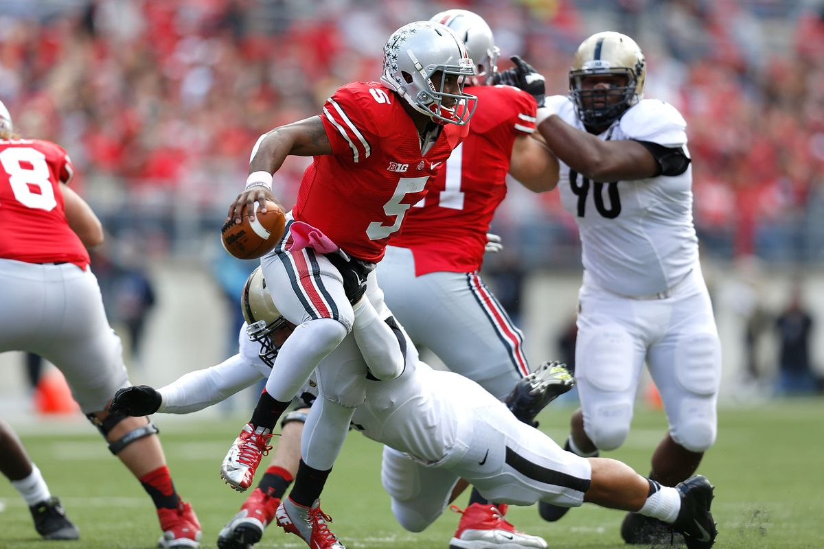Latta is seen here diving for Ohio State's Braxton Miller.