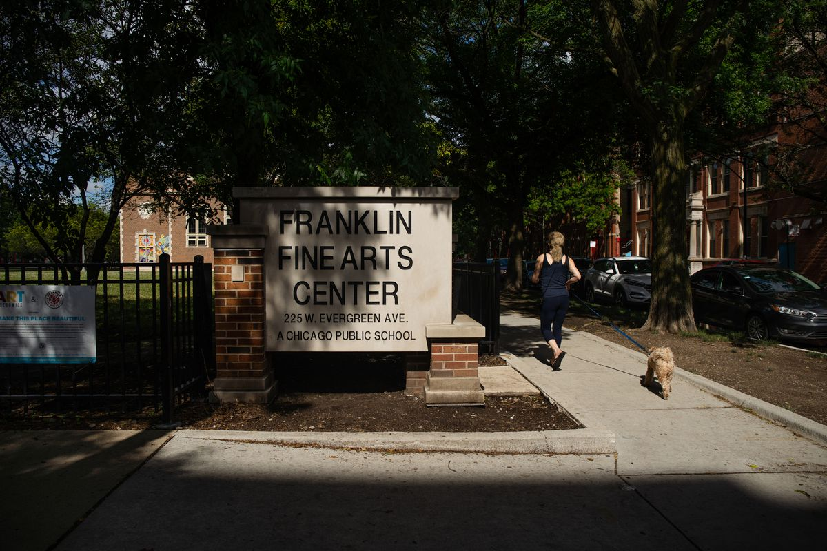 A person jogs past the Franklin Fine Arts Center in the Near North Side on June 23, 2020.