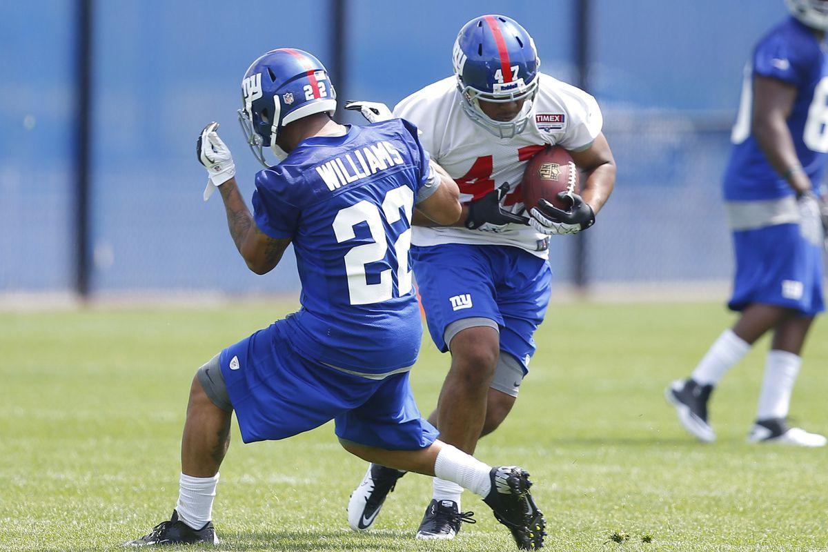 Morgan Newton runs with the ball during rookie mini-camp
