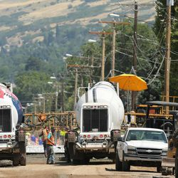 Crews work on road construction in Bountiful, Tuesday, June 30, 2015. Eighty Utah cities and towns passed or considered resolutions this month to support increased transportation funding to meet critical community needs. The funding option was made possible by HB 362.