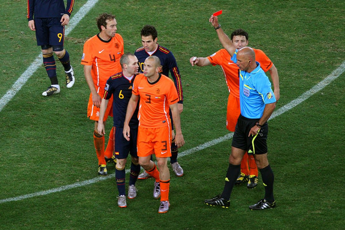 Referee Howard Webb tosses Netherlands center back John Heitinga. Yes, Spain's Carlos Puyol should have been sent off, too ... but it's not Webb's fault that Arjen Robben tried to play through the challenge ... ya know, something different for him.
