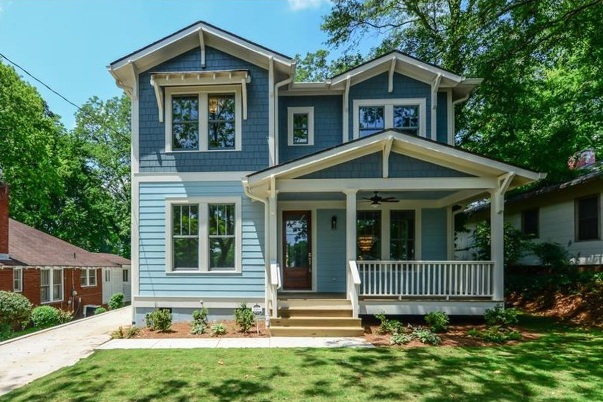 Two-story blue house with covered front porch.