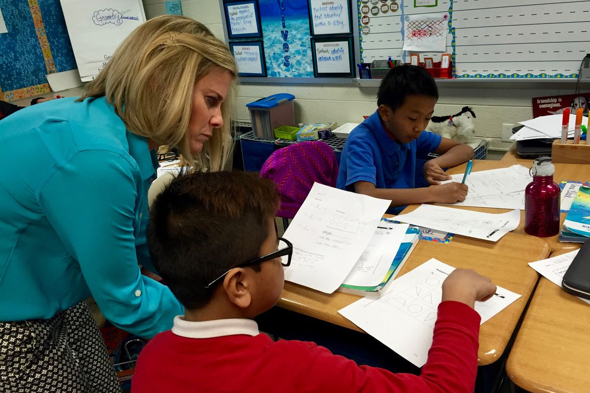 Angie Kendall, a master teacher at Southport Elementary School, works with a student. The school received an A from the state this year.