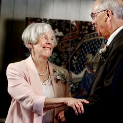 Ann Marcusen laughs with Enoch Bell during their wedding ceremony in Kaysville on Friday, April 24, 2020. The wedding was recorded on Zoom for friends and family to see. The couple met at the Bountiful Temple three years ago.