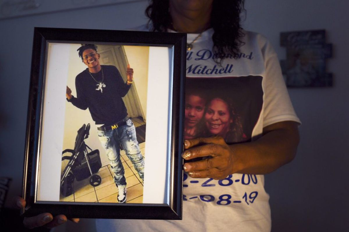 Metra Bell holds a photo of her 19-year-old son Darrell Mitchell, who was shot and killed in August 2019. The Denver school board observed a moment of silence at its January 2020 meeting for students lost to gun violence, including Mitchell.