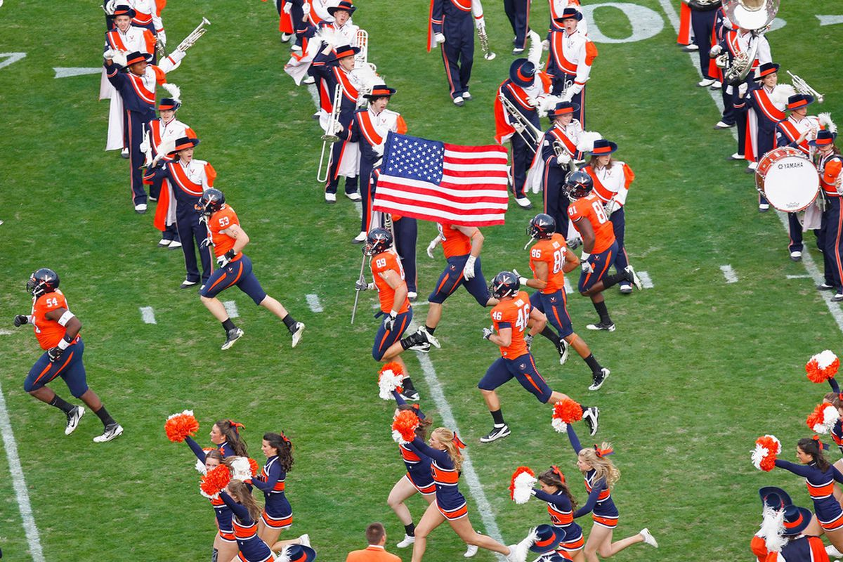 CHARLOTTESVILLE, VA - NOVEMBER 26:  The Virginia Cavaliers run onto the field prior to their game against the Virginia Tech Hokies at Scott Stadium on November 26, 2011 in Charlottesville, Virginia.  (Photo by Geoff Burke/Getty Images)