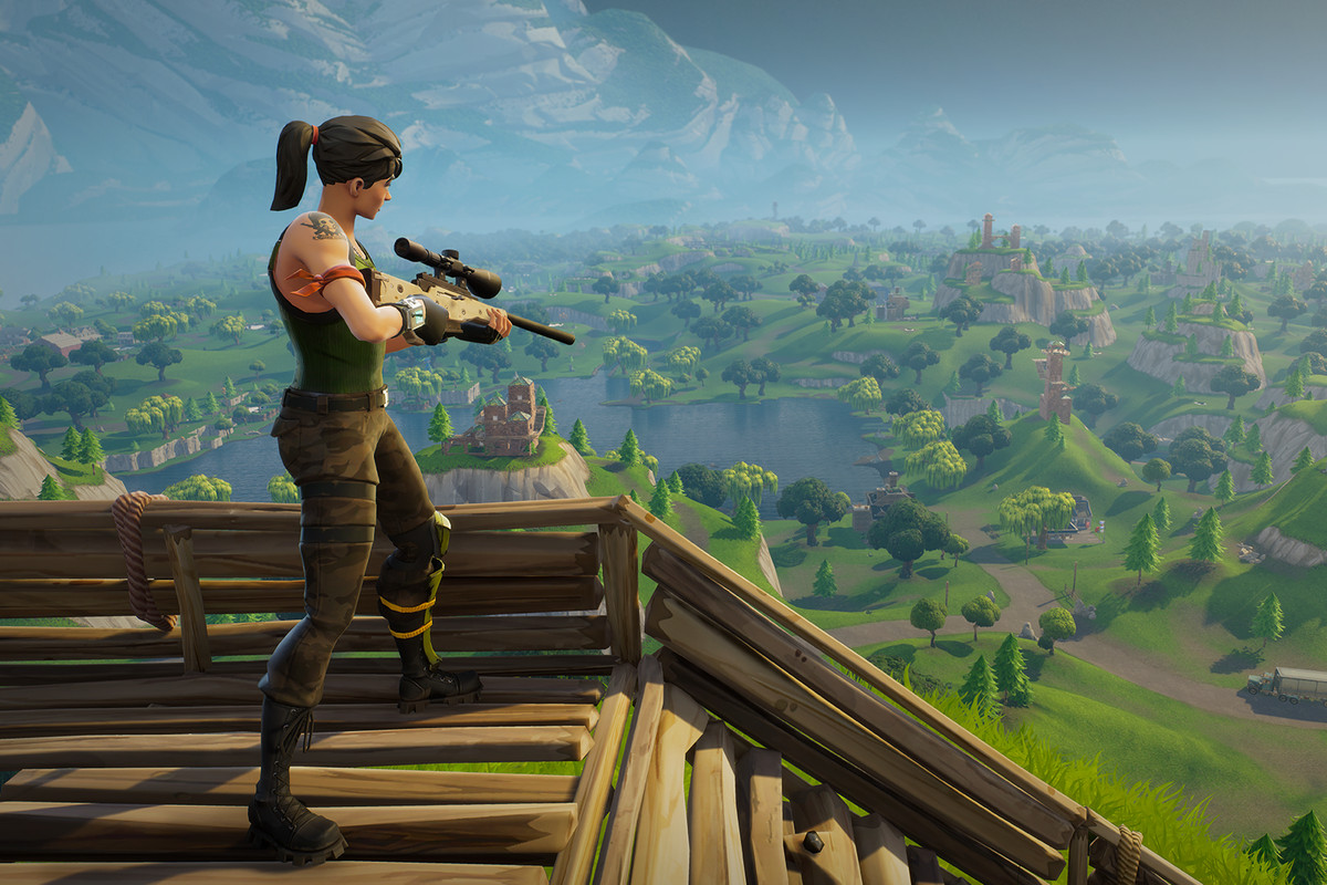 Fortnite - woman standing on a wooden structure with a sniper rifle