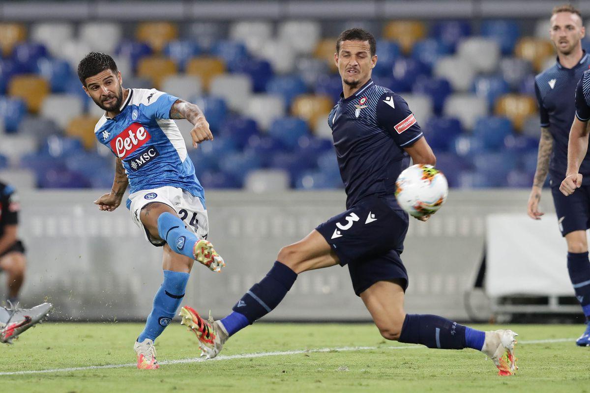 Napoli's Italian striker Lorenzo Insigne fights for the ball...