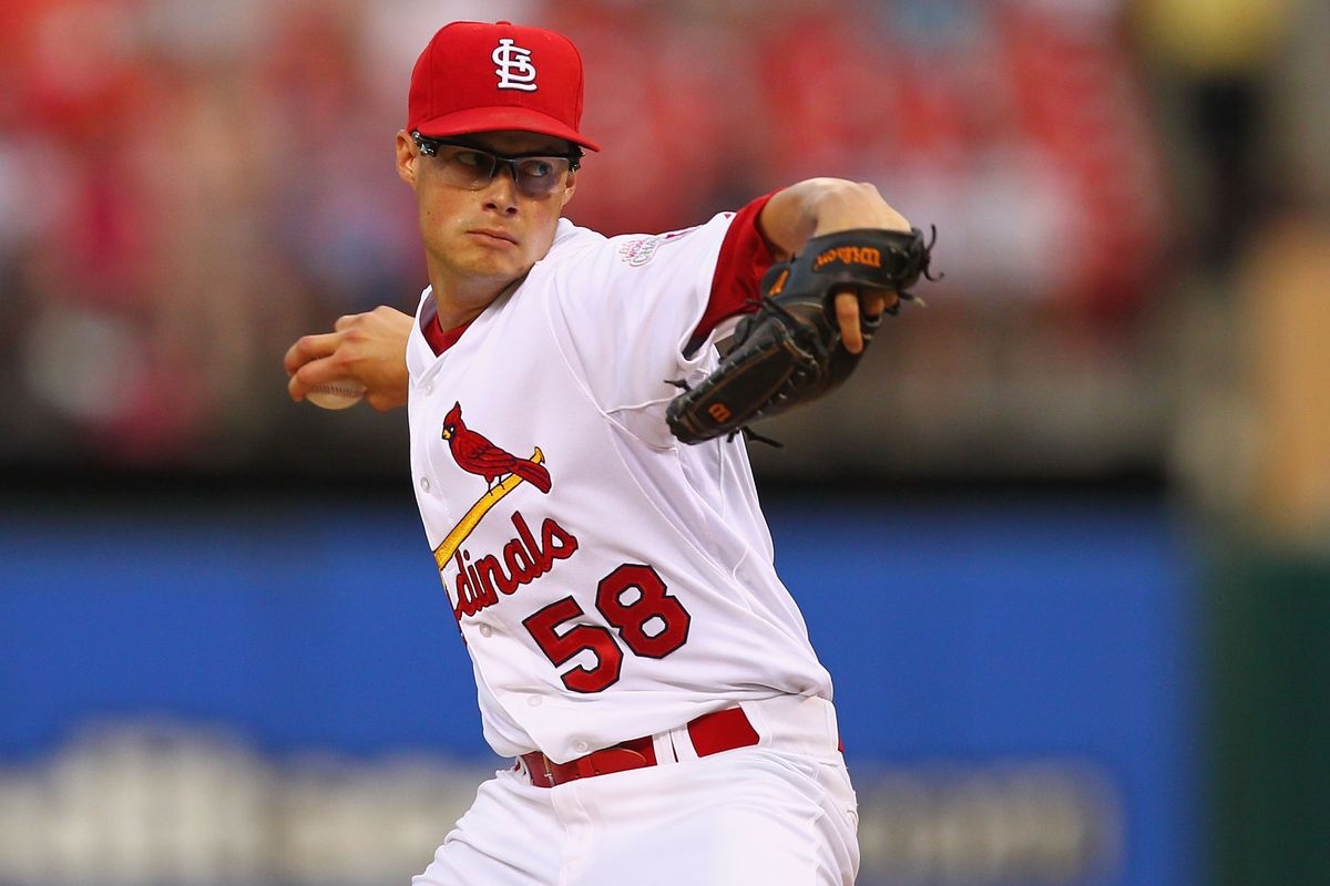 ST. LOUIS, MO - AUGUST 8: Starter Joe Kelly #58 of the St. Louis Cardinals pitches against the San Francisco Giants at Busch Stadium on August 8, 2012 in St. Louis, Missouri.  (Photo by Dilip Vishwanat/Getty Images)