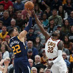 Cleveland Cavaliers forward Jeff Green (32) blocks a shot from Utah Jazz forward Thabo Sefolosha (22) at Vivint Arena in Salt Lake City on Saturday, Dec. 30, 2017.
