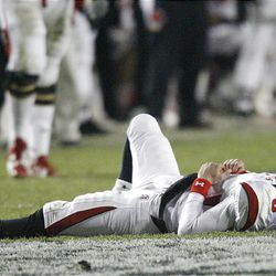 Utah quarterback Jordan Wynn is on the ground after being hit hard by BYU in the game at LaVell Edwards Stadium in Provo Saturday. BYU won in overtime 26-23.