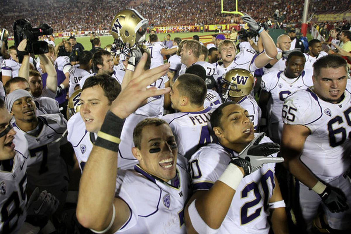 LOS ANGELES CA - OCTOBER 02:  The Washington Huskies celebrate after the game with the USC Trojans at the Los Angeles Memorial Coliseum on October 2 2010 in Los Angeles California.  Washington won 32-31.  (Photo by Stephen Dunn/Getty Images)