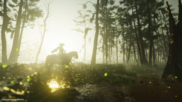 A samurai rides a horse through a forest with the sun behind them in Ghost of Tsushima