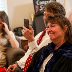 Anita Hallman tears up hearing her University of Utah grad give his mock valedictorian speech amid the COVID-19 pandemic in her Sugar House home on Thursday, April 30, 2020. Joseph Hallman earned bachelor's degrees in Latin American studies, Spanish and international business with an emphasis in trade commerce in 2019 with hopes of walking during the spring 2020 commencement ceremony.