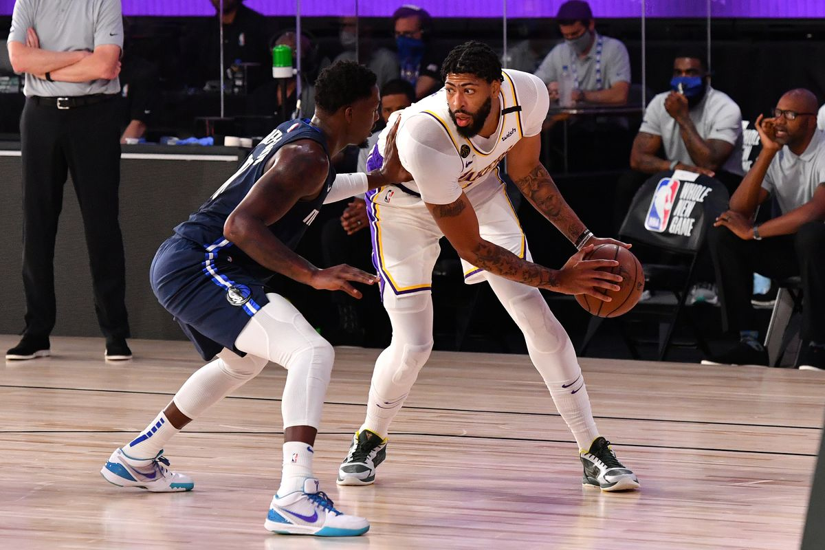 Anthony Davis of the Los Angeles Lakers handles the ball against the Dallas Mavericks on July 23, 2020 at the Visa Athletic Center at ESPN Wide World of Sports Complex in Orlando, Florida.