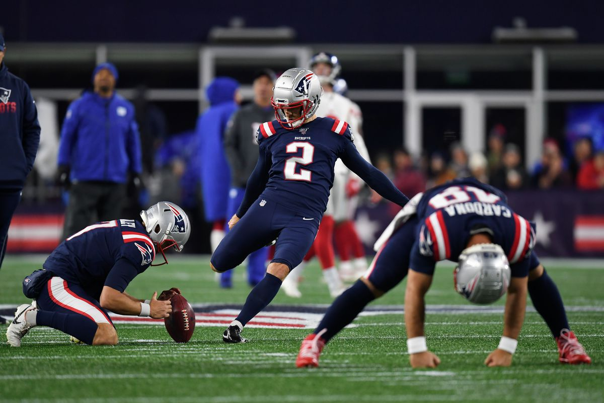 New England Patriots kicker Mike Nugent warms-up before a game against the New York Giants at Gillette Stadium.