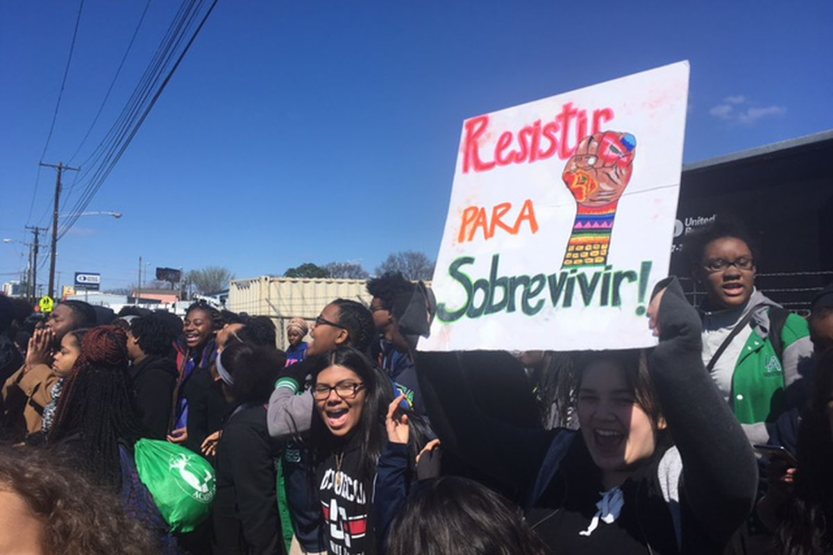 Students at Nashville's LEAD Academy High School protest President Trump's policies to coincide with his visit to the city later in the day.