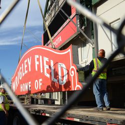 2:10 p.m. The top segment of the marquee being lowered onto the flatbed truck -