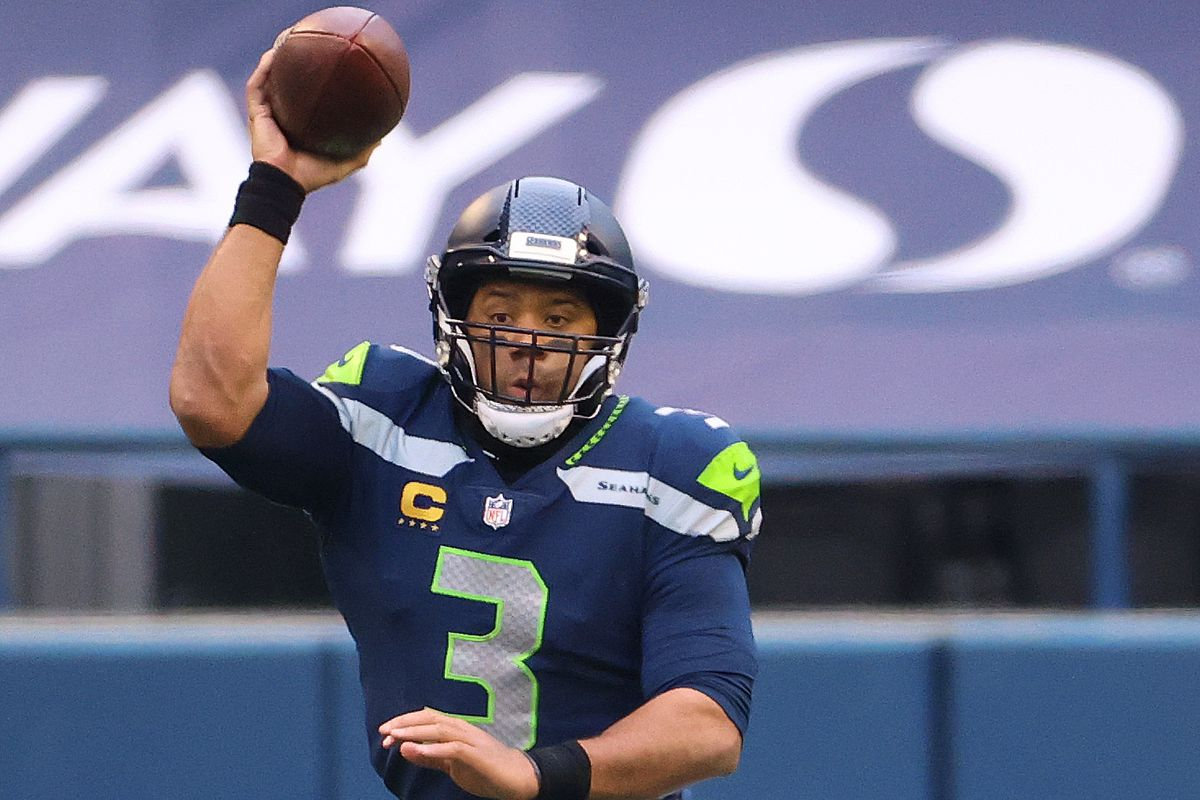 Russell Wilson #3 of the Seattle Seahawks looks to throw the ball in the second quarter against the Los Angeles Rams during the NFC Wild Card Playoff game at Lumen Field on January 09, 2021 in Seattle, Washington.