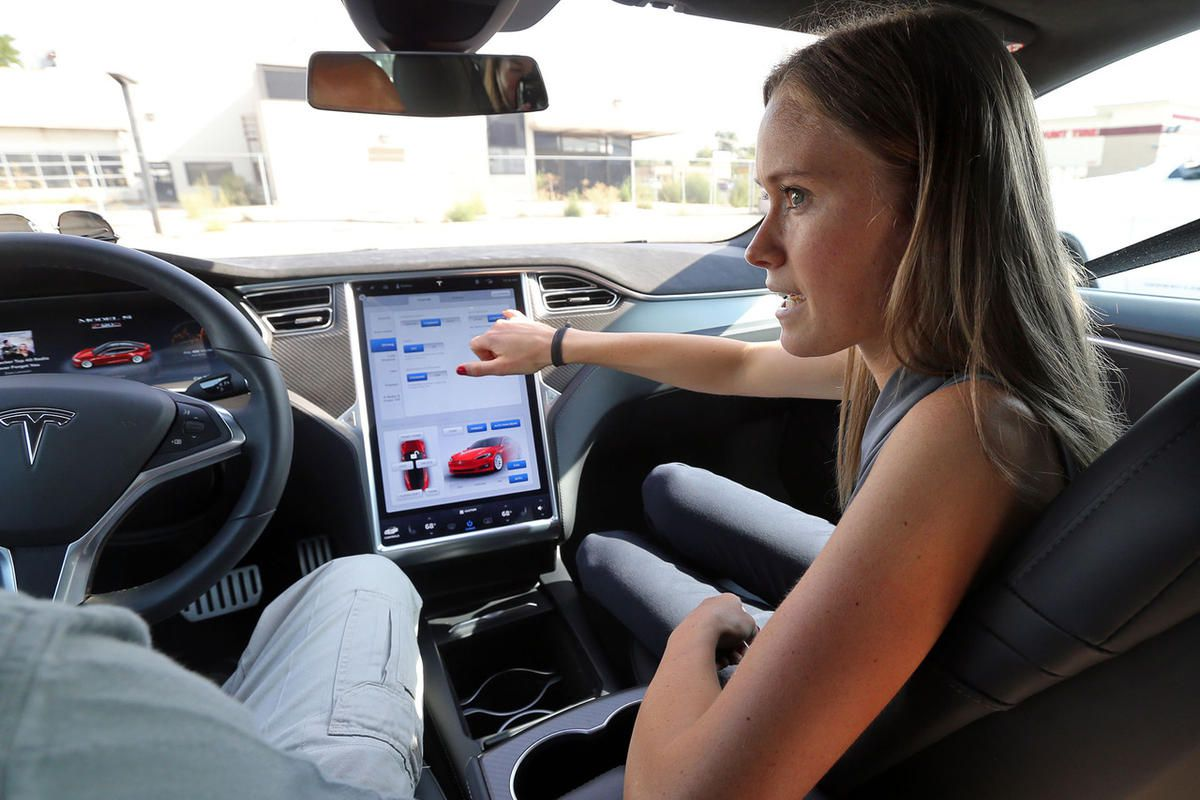 Sonja Koch, Tesla communications spokeswoman, shows some of the features in a Tesla Model S P90D outside the Tesla showroom in Salt Lake City on Tuesday, Aug. 23, 2016.