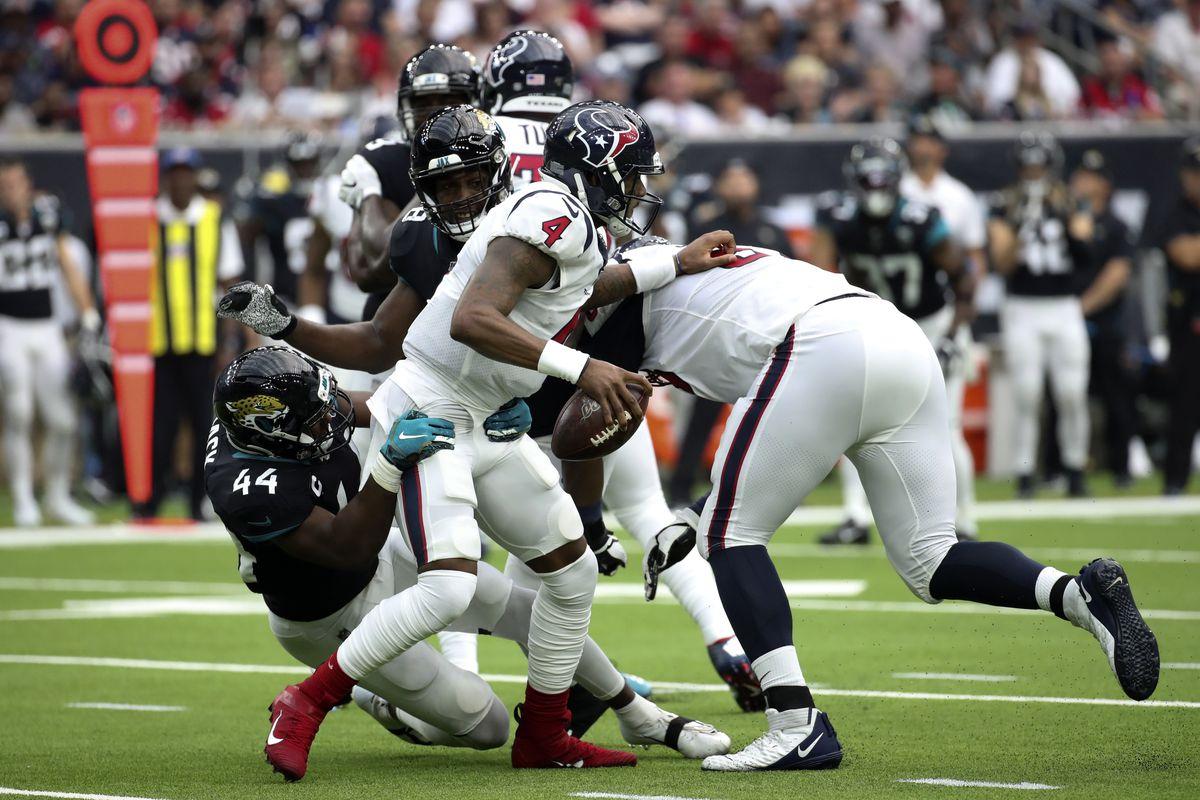 Jacksonville Jaguars middle linebacker Myles Jack and outside linebacker Leon Jacobs sack Houston Texans quarterback Deshaun Watson during the second quarter at NRG Stadium.