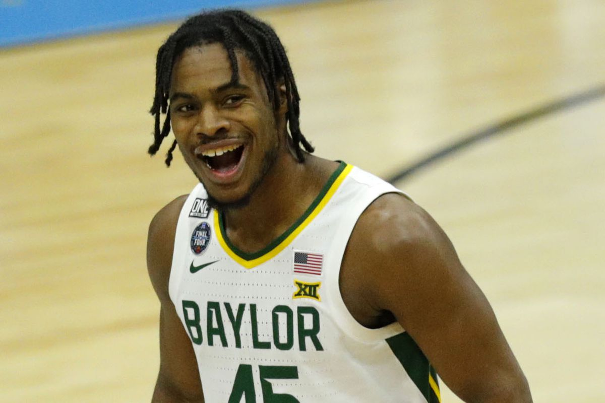 Baylor Bears guard Davion Mitchell celebrates after hitting a three-pointer against Houston during the semifinals of the Final Four of the 2021 NCAA Tournament on Saturday, April 3, 2021, at Lucas Oil Stadium in Indianapolis, Ind.
