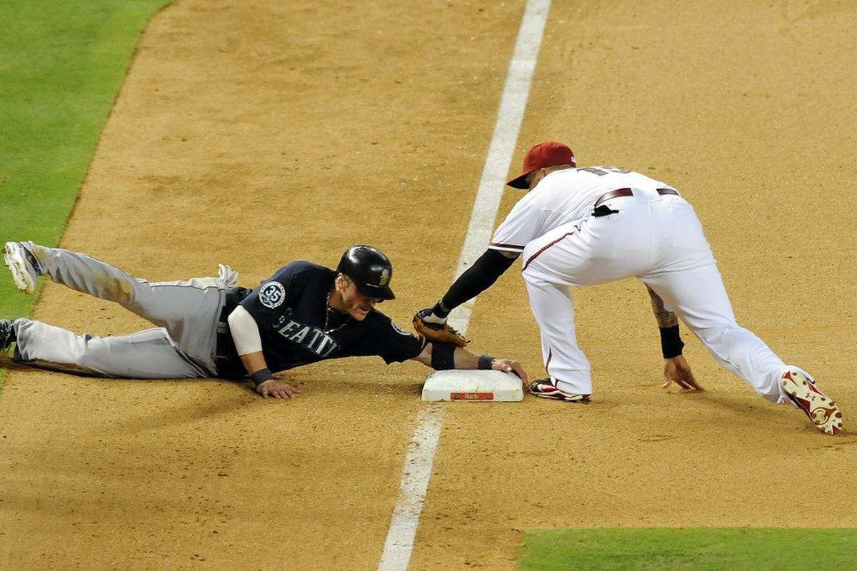 PHOENIX, AZ - JUNE 19:  Josh Bell #15 of the Arizona Diamondbacks attempts to tag out a sliding Brendan Ryan #26 of the Seattle Mariners at Chase Field on June 19, 2012 in Phoenix, Arizona.  (Photo by Norm Hall/Getty Images)