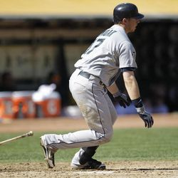 Seattle Mariners' Justin Smoak watches his RBI single hit off Oakland Athletics' Tommy Milone in the third inning of a baseball game Sunday, Sept. 30, 2012, in Oakland, Calif.