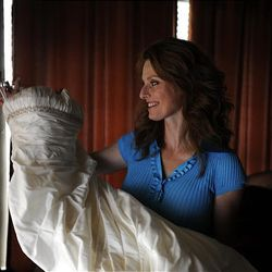 Julie Caldwell, 39, looks at her wedding dress at her home, June 17, 2010 in Ennis, Texas.