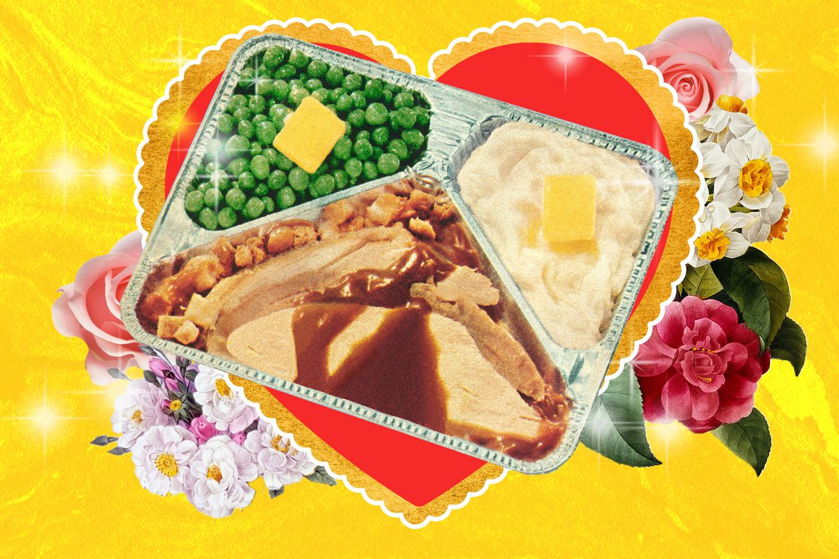 A 1950s frozen dinner containing salisbury steak, potatoes, and peas, atop a retro valentine card.