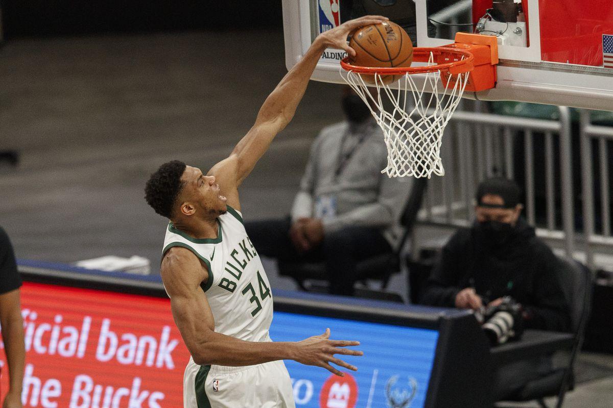 Milwaukee Bucks forward Giannis Antetokounmpo (34) dunks during the first quarter against the Oklahoma City Thunder at Fiserv Forum.
