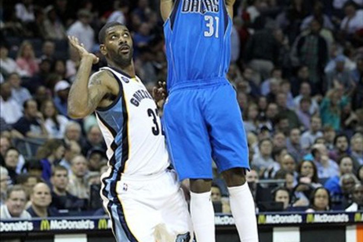 Feb 29, 2012; Memphis, TN, USA; Dallas Mavericks guard Jason Terry (31) shoots while defended by Memphis Grizzlies guard O.J. Mayo (32) during the first half at the FedEx Forum. Mandatory Credit: Nelson Chenault-US PRESSWIRE