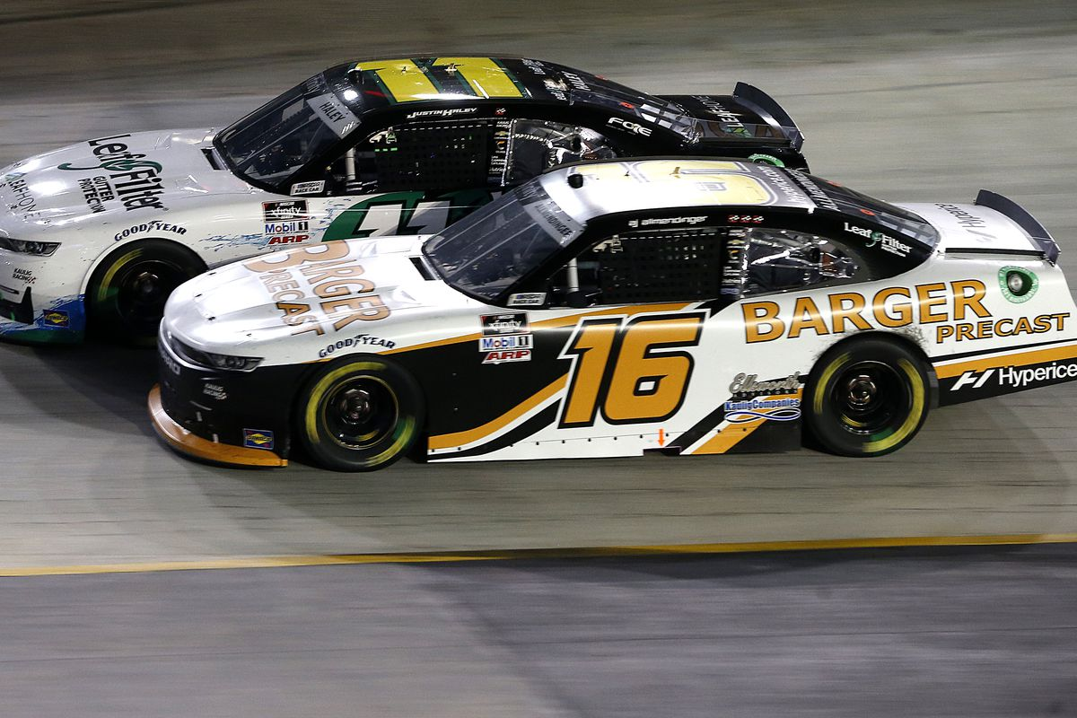 AJ Allmendinger, driver of the #16 Barger Precast Chevrolet, and Justin Haley, driver of the #11 LeafFilter Gutter Protection Chevrolet, race during the NASCAR Xfinity Series Food City 300 at Bristol Motor Speedway on September 17, 2021 in Bristol, Tennessee.