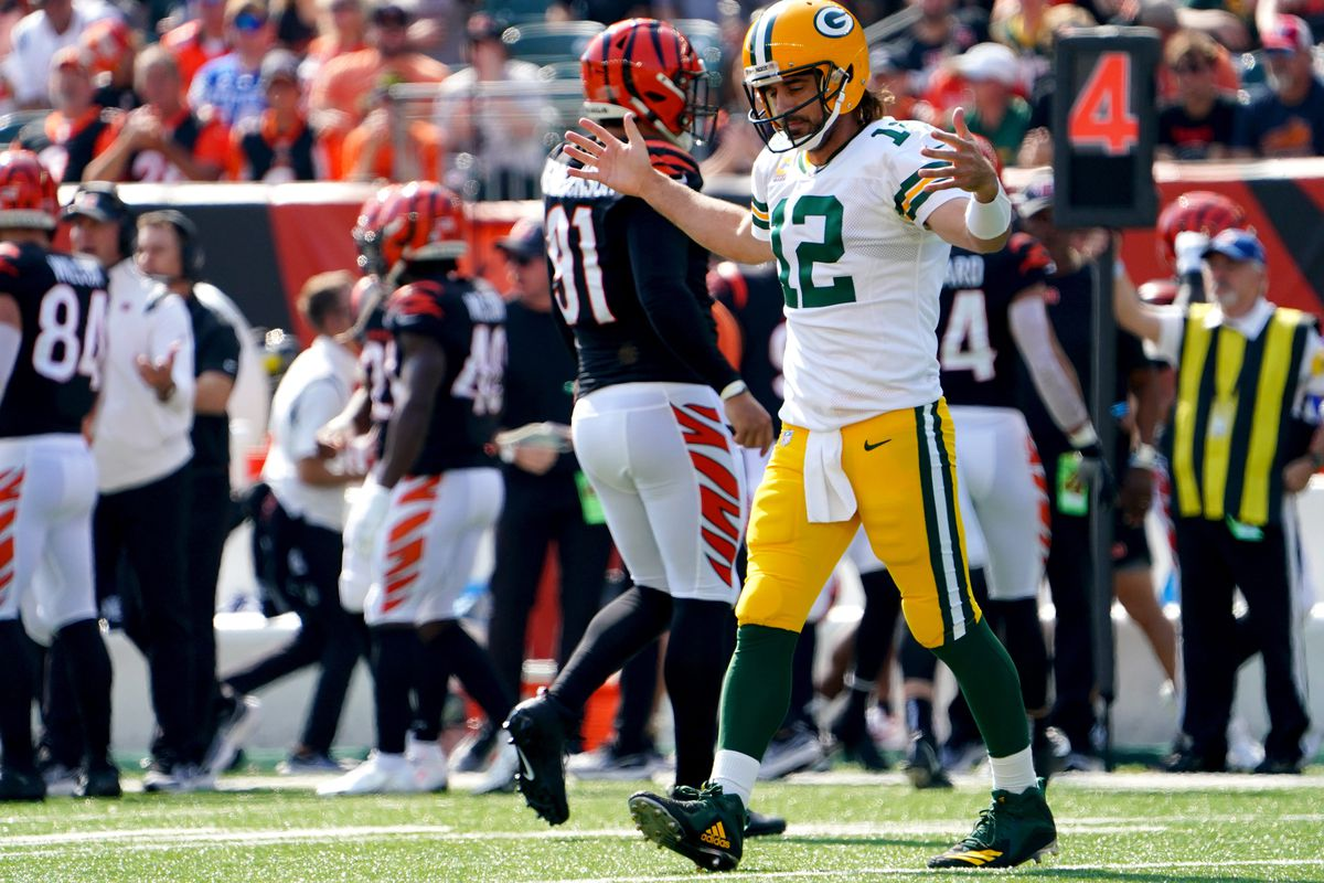Green Bay Packers quarterback Aaron Rodgers (12) expresses frustration and walks off the field in the first quarter of a Week 5 NFL football game against the Cincinnati Bengals, Sunday, Oct. 10, 2021, at Paul Brown Stadium in Cincinnati.