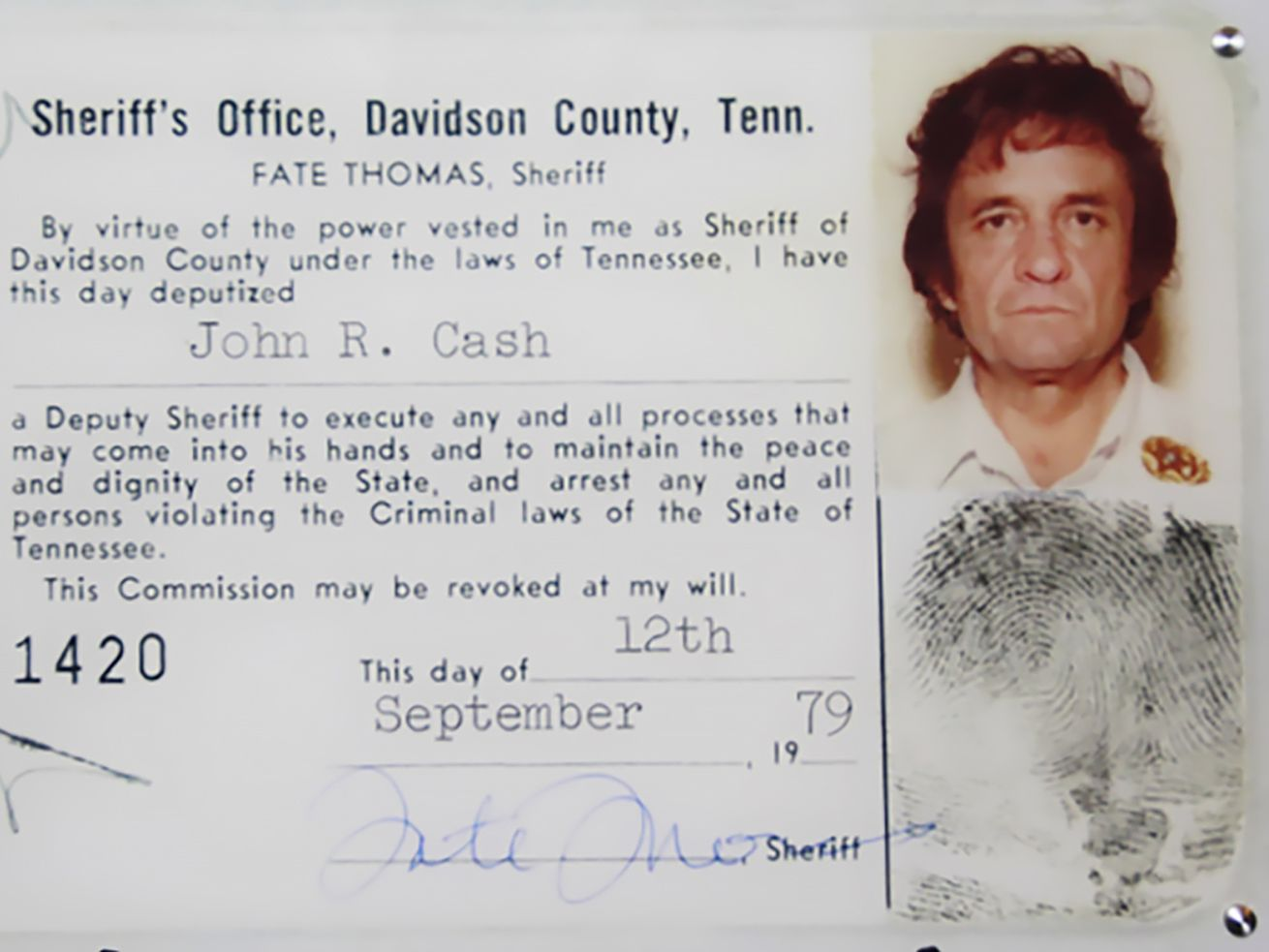 Shows Cash's Deputy Sheriff ID card.