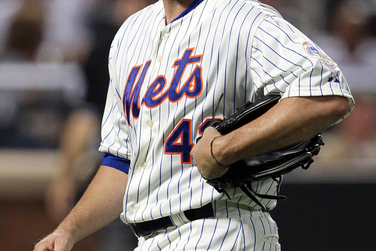 July 24, 2012; New York, NY, USA; New York Mets pitcher R.A. Dickey (43) walks off the field after giving up four runs to the Washington Nationals during the sixth inning of a game at Citi Field. Mandatory Credit: Brad Penner-US PRESSWIRE
