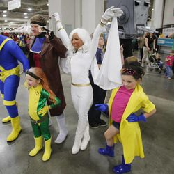 Costumed attendees pose for photographs at Comic Con at the Salt Palace in Salt Lake City Thursday, April 17, 2014.