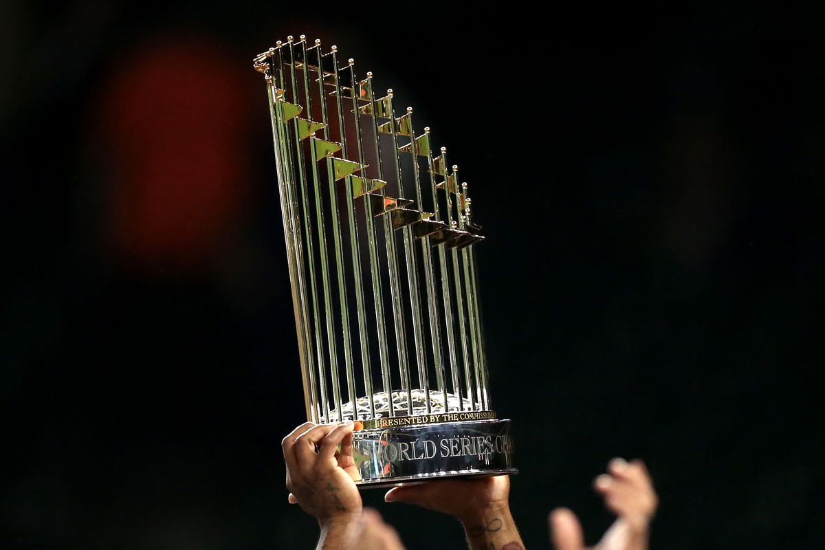 Members of the Washington Nationals celebrate with the Commissioner's Trophy after the Nationals defeated the Houston Astros in Game 7 to win the 2019 World Series at Minute Maid Park.