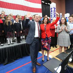 GOP presidential candidate and Texas Sen. Ted Cruz, with his wife Sharon, wave to the crowd at a rally in Draper at the American Preparatory Academy Saturday, March 19, 2016.