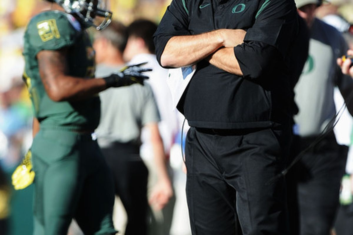 PASADENA, CA - JANUARY 02:  Head coach Chip Kelly of the Oregon Ducks looks on from the sideline in the first half against the Wisconsin Badgers at the 98th Rose Bowl Game on January 2, 2012 in Pasadena, California.  (Photo by Harry How/Getty Images)