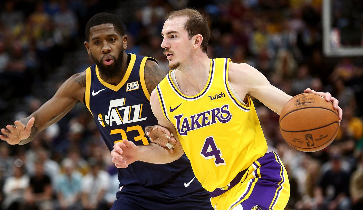 Utah Jazz forward Royce O'Neale defends Los Angeles Lakers guard Alex Caruso as the Utah Jazz and Lakers play at Vivint Arena in Salt lake City on Wednesday, March 27, 2019.