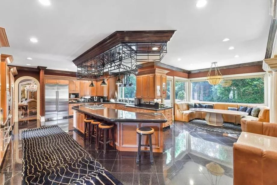 A huge kitchen with a long row of banquette seating.