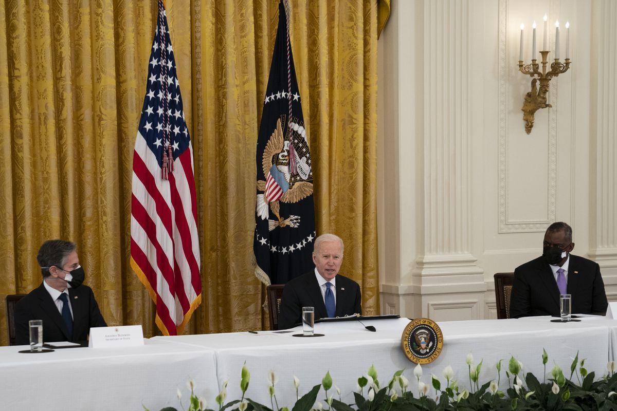 Secretary of State Antony Blinken, left, and Secretary of Defense Lloyd Austin listen as President Joe Biden speaks during a Cabinet meeting in the East Room of the White House, Thursday, April 1, 2021, in Washington.